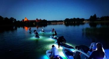 Naktinis irklenčių turas aplink Trakų pilį